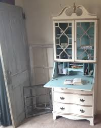 white painted wood secretary pull down desk with curved drawer and