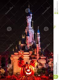 disneyland paris castle during halloween celebration at night
