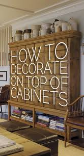 how to decorate the top of a cabinet and how not to u2014 designed