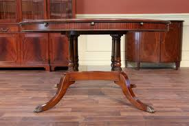 large round walnut dining room table with leaves seats 6 10 people