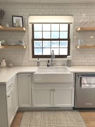 kraftmaid dove white kitchen cabinets this farmhouse sink pairs nicely with these cabinets and