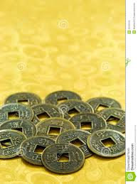 new year gold coins lucky coins on gold background new year stock