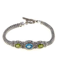 blue topaz bracelet images Bali designs by robert manse 4ctw peridot and swiss blue topaz jpg