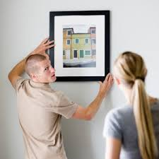 how to hang a painting how to hang paintings in a straight line