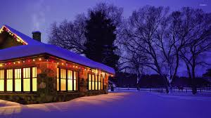 christmas lights decorating the snowy house wallpaper world