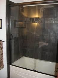 image of semi frameless sliding doors on an tiled shower enclosure