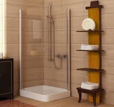 cozy with brown small bathroon accent with corner enclosure shower