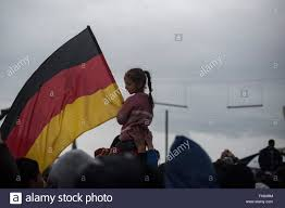 The Germany Flag The German Flag Is Shown In A Manifestation At The Refugee Camp Of