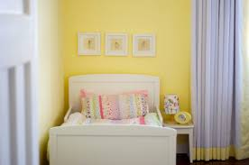 simple white girls room set with yellow wall paint color