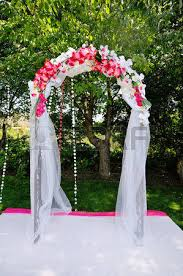Wedding Arches To Purchase Wedding Arch With Flowers On The Grass Stock Photo Picture And