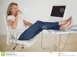 Feet On The Desk Businesswoman With Feet On Table Taking Off Shoes Royalty Free