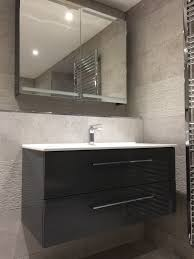 contemporary wet room with textured tiles from curtis brothers