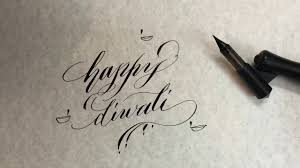 writing happy diwali in simple calligraphy style for beginners