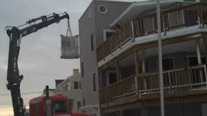 hoisting move with a crane on long beach island by jersey shore