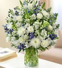 White Roses In A Vase Sincerest Sorrow All White By 1 800 Flowers White Mixed Flowers