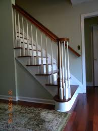 Stairs With Laminate Flooring Wood Stairs And Rails And Iron Balusters Brazilian Cherry Stair