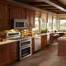 dwell of decor shaker style cabinets in casual kitchen d b gray benches stainless wall mount sinks brown base cabinets brown tile flooring beautiful kitchen design ideas