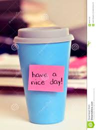 text have a nice day in a cup of coffee or tea stock photo image
