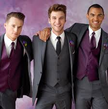 make the groom stand out with a different color palette tuxedos
