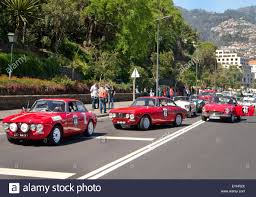 classic alfa romeo gta and gtv cars taking part in the madeira