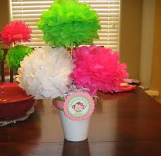 inexpensive tissue pom centerpiece good for fundraiser events