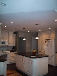 outstanding two pendant lamps over small black and white kitchen