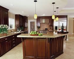 dark wood cabinet kitchens kitchen wall colors with dark cabinets round stone above the