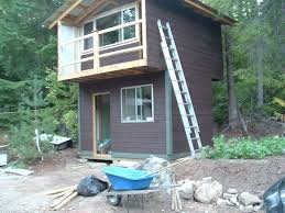 two story tiny house with a balcony the ultimate micro cabin