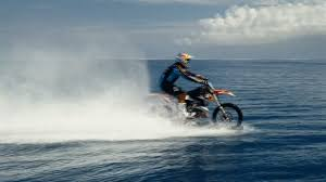 motocross bike on finance motocross pro tackles huge waves on his bike cnn video