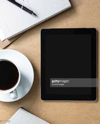 tablet computer on table with book and coffee stock photo getty