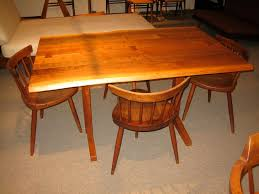 george nakashima cherry dining table and four windsor armchairs