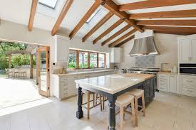 Hacienda Home Interiors by Open Vaulted Ceiling Kitchen Design With White Cabinet Interior