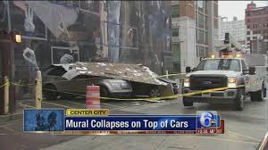 part of center city mural falls on parked cars amid high winds part of center city mural falls on parked cars amid high winds 6abc com