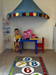 playroom makeover with lego table hopscotch rug canopy tent