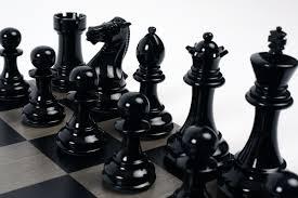 bold chess metallic gold v shadow black wooden chess set