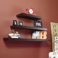 decorative l shaped dark glaze floating shelf on light brown wall
