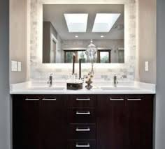 black and white checkerboard floor tiles with simple vanity