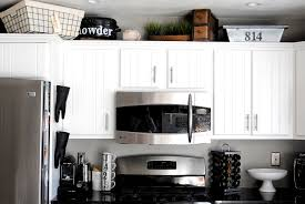 Ways To Use The Space Above Your Kitchen Cabinets - Above kitchen cabinet storage