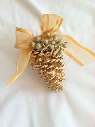 simply loop or tie twine around the middle of each pine cone and