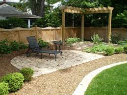 Backyard Landscape Ideas by Black Chaise Lounge And Corner Wooden Pergola For Simple Backyard