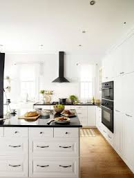 black and white kitchen with range hood kitchen design ideas