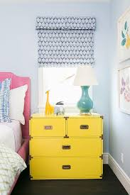 pink kids bed with yellow campaign nightstand contemporary