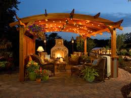 astounding outdoor patio with stone fireplace and pergola with