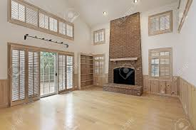 two story family room with brick fireplace stock photo picture