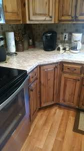 best 25 knotty alder kitchen ideas on pinterest farmhouse rustic knotty alder kitchen cabinets with black glaze spring carnival countertop