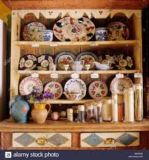 country style dresser with an eclectic collection of crockery in