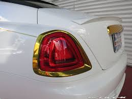 rolls royce gold and red white rolls royce wraith with gold accents from office k is an