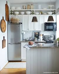 what to put on top of kitchen cabinets for decoration 11 smart ways to use the space above your cabinets kitchn