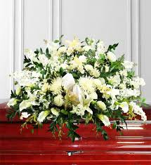 white sympathy casket spray avas flowers