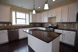 which upgrades are worth it kitchen with white cabinets green and cream backsplash dark hardware